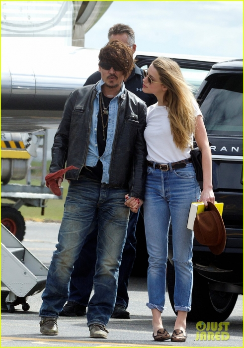 johnny-depp-amber-heard-hold-hands-for-australian-arrival-11.jpg