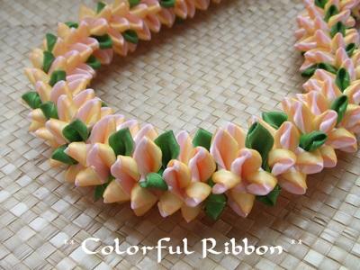 RainbowPlumeriaBlossoms.jpg