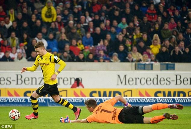 Marco Reus skips round Stuttgart goalkeeper