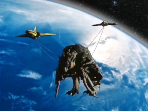 シーラ(シーラキート)の亡骸を宇宙に運ぶGUTS